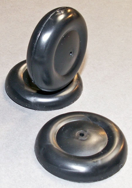 "1"" and 1 1/2"" black plastic wheel halves"